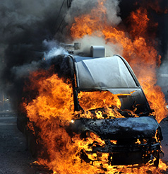 a van on the street explodes in flames